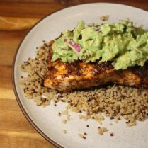 grilled salmon with avocado salsa over quinoa