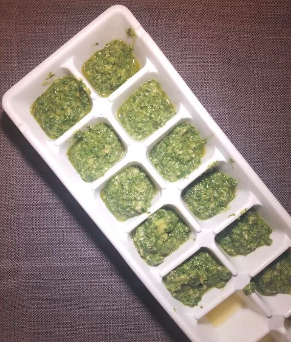 freezing pesto in ice trays.JPG