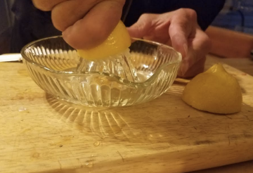 Juicing a lemon for chicken piccataa.png